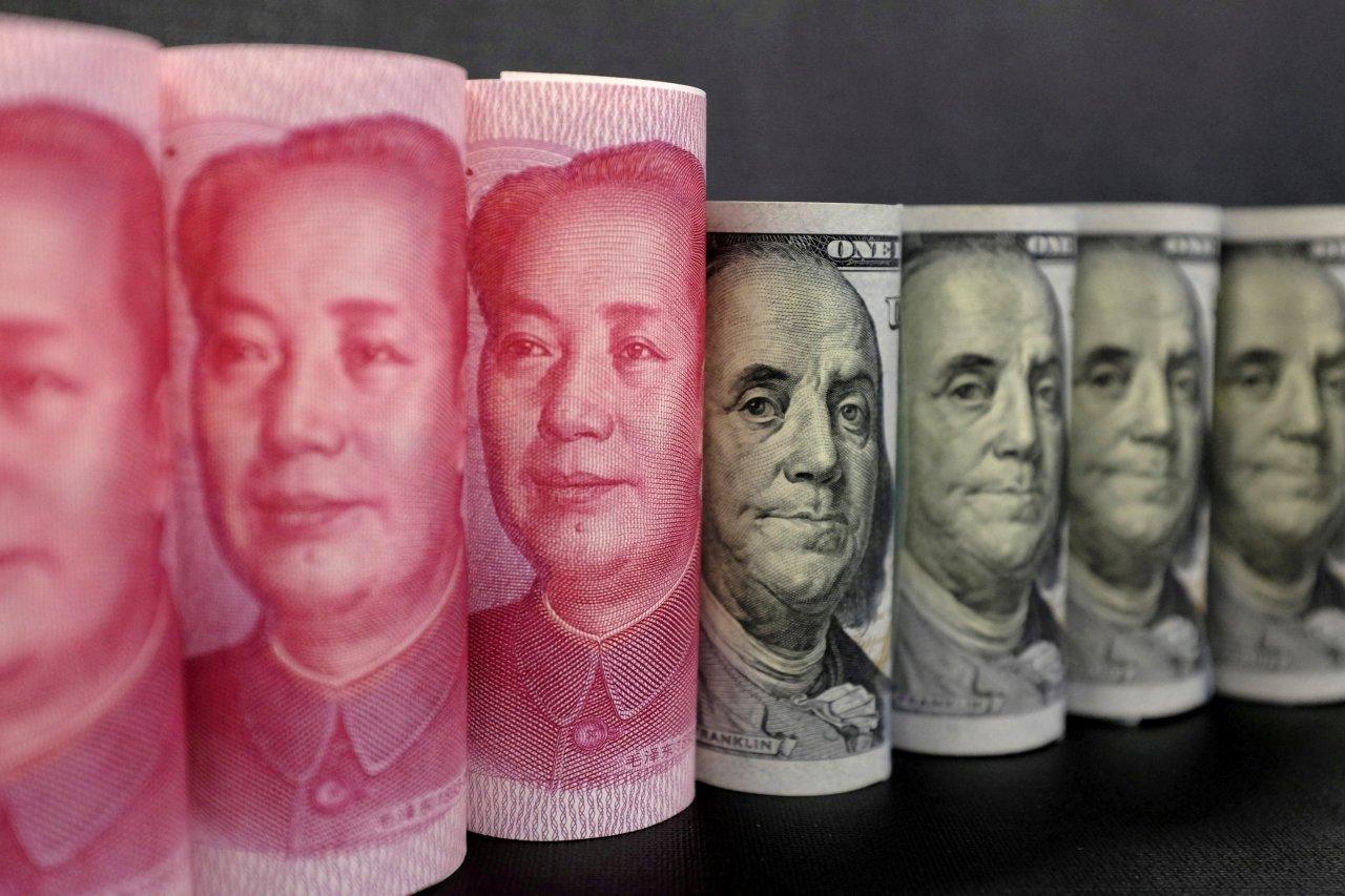 美元指数创逾一年新高人民币中间价下调234点